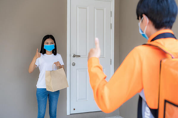 asian-woman-pick-up-delivery-food-bag-from-door-knob-thumb-up-form-contactless-contact-free-from-delivery-rider-with-bicycle-front-house-social-distancing-infection-risk-coronavirus-concept_73503-1925