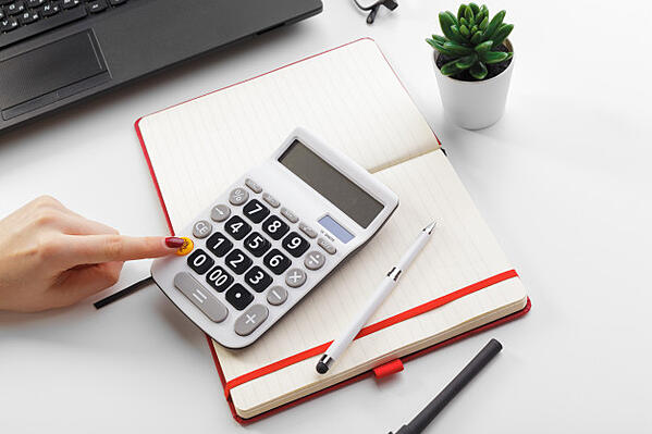 business-woman-working-with-financial-data-hand-using-calculator_127657-7812