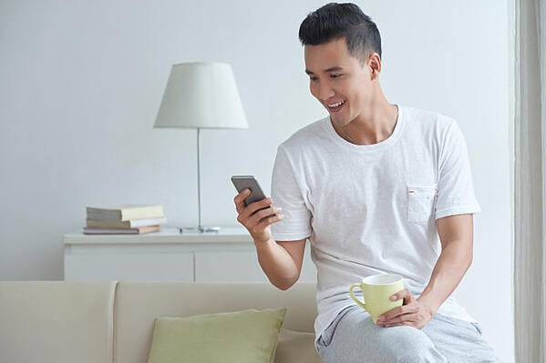medium-shot-young-gut-busy-texting-messages-his-social-media-smartphone-morning_1098-19231