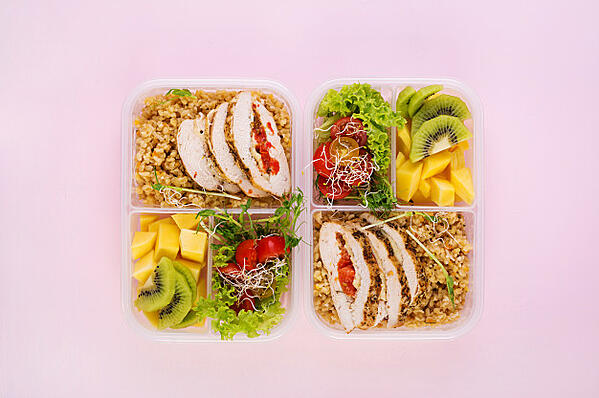 lunch-box-chicken-bulgur-microgreens-tomato-fruit-healthy-fitness-food-take-away-lunchbox-top-view_2829-19675