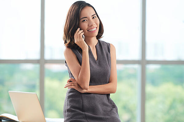 young-asian-businesswoman-chatting-phone_1098-18008