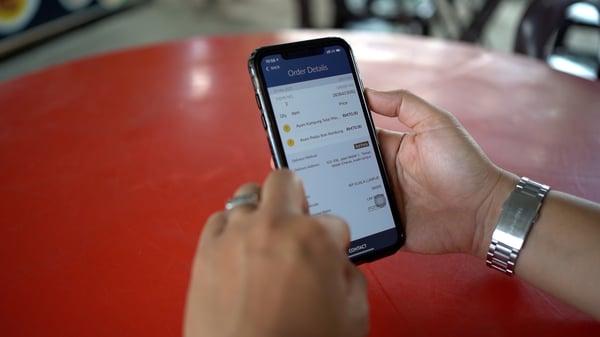 Merchant using the Sama-Sama Lokal app