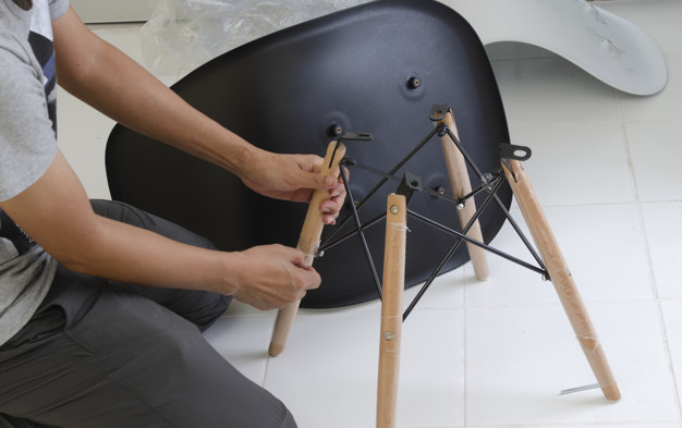carpenter-putting-together-parts-chair_34792-33